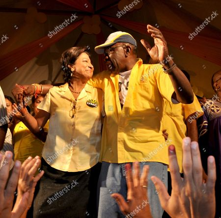 Kamla Persad-Bissessar, Austin Jack Warner FIFA Vice President, Austin Jack Warner, right, congratulates Prime Minister-elect Kamla Persad-Bissessar at the party headquarters on the night of the general election, in Port of Spain, late . Persad-Bissessar is set to become the first woman prime minister in the energy-rich Caribbean nation