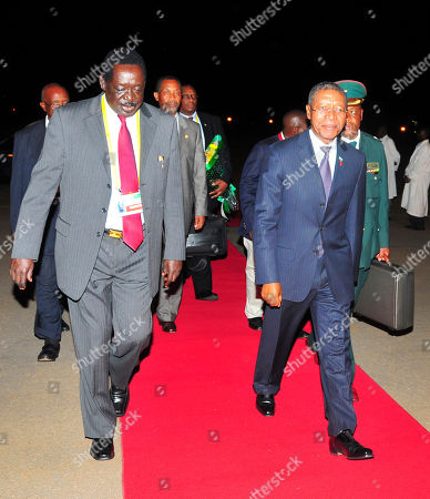 Uganda Minister for Housing Omara Atubo, left, with Lesotho's Prime Minister, Pakalitha Mosisili, right, on his arrival at Entebbe International Airport Uganda for the African summit . African heads of state are due to meet in the Ugandan capital, Kampala, from Sunday for the 15th African Union Summit