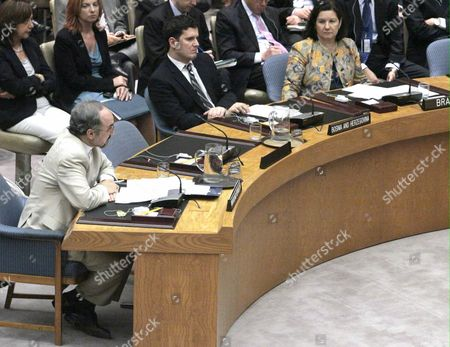 Iran's United Nations U.S. Ambassador Mohammad Khazaee, bottom left, speaks before the United Nations Security Council in New York after vote to impose sanctions on Iran