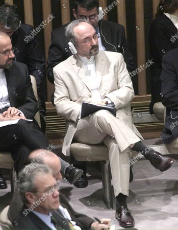"""Iran's United Nations Ambassador Mohammad Khazaee listens to discussions after the United Nations Security Council voted on sanctions against Iran, . The U.N. Security Council approved new sanctions against Iran over its suspect nuclear program. The sanctions target the country's powerful Revolutionary Guard, ballistic missiles, and nuclear-related investments.The resolution imposing a fourth round of sanctions against Iran was approved Wednesday with 12 """"yes"""" votes, two """"no"""" votes from Brazil and Turkey, and one abstention from Lebanon"""