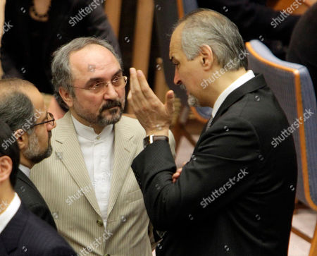 Mohammad Khazaee, Bashar Ja'afari Iran's Ambassador Mohammad Khazaee, center, and Syria's Ambassador Bashar Ja'afari, right, get together before a session of the United Nations Security Council, . Person with back to cameras is unidentified. The U.N. Security Council is to vote Wednesday on widespread targeted sanctions against Iranian agencies, companies and individuals in an attempted clampdown over Iran's nuclear developments