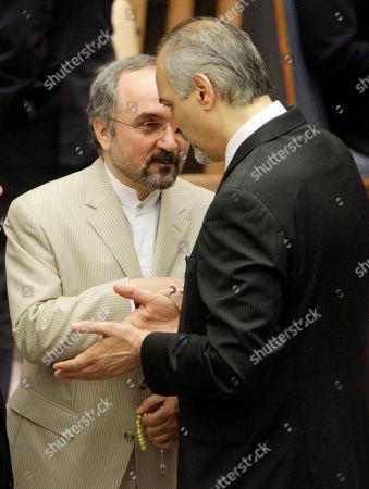 Mohammad Khazaee, Bashar Ja'afari Iran's Ambassador Mohammad Khazaee, left, and Syria's Ambassador Bashar Ja'afari, right, speak before a session of the United Nations Security Council