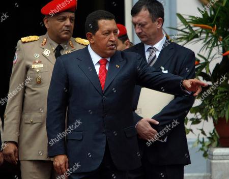 Hugo Chavez Venezuela's President Hugo Chavez, front, gestures prior to a welcoming ceremony for Abkhazia's President Sergei Bagapsh and South Ossetia's President Eduard Kokoity at Miraflores presidential palace in Caracas, Venezuela