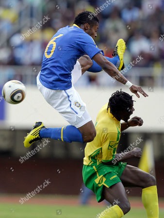 Brazil's Michel Bastos, left, fights for a ball with Zimbabwe's Benjani Mwaruwari, during a friendly match in Harare, Zimbabwe, . Brazilian team is preparing for the upcoming South Africa World Cup, which gets underway on June 11