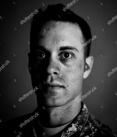 Stock Picture of In this photograph taken, Sgt. Thomas Riordan, 25,of Grand Island, New York, poses for a portrait at Forward Operating Base Bostick in Kunar province, north-east of Kabul, Afghanistan. Sgt. Thomas Riordan didn't want to return to Afghanistan after home leave. He had just fought through a battle that killed eight soldiers, and when he arrived home his wife said she was leaving. He almost killed himself that night