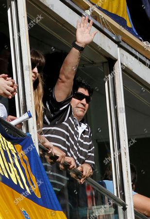 Diego Maradona, Dalma Maradona Argentina's coach Diego Maradona, right, accompanied his daughter Dalma Maradona, waves prior to an Argentinean soccer league match between Boca Juniors and River Plate in Buenos Aires