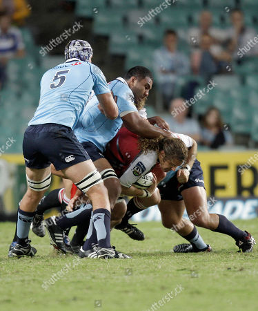 Todd Clever, Kane Douglas, Wycliff Palu Lions' Todd Clever, center, is slowed down by Waratahs' Kane Douglas and teammate Wycliff Palu during their Rugby Super 14 match in Sydney, Australia