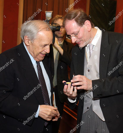 Pierre Boulez, Clemens Hellsberg Clemens Hellsberg, right, head of the Vienna Philharmonic orchestra presents to French conductor and composer Pierre Boulez, left, a golden coin during the birthday celebration of Pierre Boulez 85th birthday in Vienna's Musikverein, Austria, on