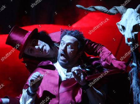 "Karl Markovics, Falk Struckmann Karl Markovics as Samiel and Falk Struckmann as Kaspar, from left, perform during a dress rehearsal for the opera "" Der Freischuetz"" composed by Carl Maria von Weber at the Theater an der Wien in Vienna, Austria, on . Premiere of the opera is on Monday, April 19, 2010, staged by Oscar-winning director Stefan Ruzowitzky"
