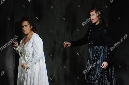 """Katarina Dalayman, Anne Sofie von Otter Katarina Dalayman, left, as Bruennhilde and Anne Sofie von Otter in the role of Waltraute perform during a dress rehearsal for Richard Wagner's opera """"Goetterdaemmerung"""" which is part of the Salzburg Easter Festival, in Salzburg, Austria. The premiere of the production under the musical direction of Sir Simon Rattle is scheduled for Saturday, March 27, 2010"""