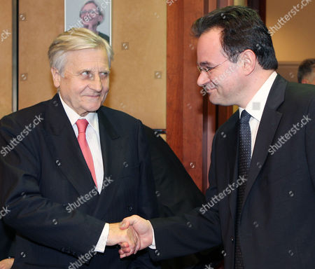 Giorgos Papakonstantinou, Jean-Claude Trichet European Central Bank President Jean-Claude Trichet, left, shakes hands with Greek Finance Minister Giorgos Papakonstantinou, at the European Council building in Brussels, . Finance Ministers of the 16 nations using the euro met on Sunday to review a proposed bailout for Greece