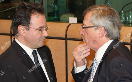 Giorgos Papakonstantinou, Jean-Claude Juncker Greek Finance Minister Giorgos Papakonstantinou, left, talks with Luxembourg's Finance Minister and Chairman of the Eurogroup Jean-Claude Juncker, at the European Council building in Brussels, . Finance Ministers of the 16 nations using the euro met on Sunday to review a proposed bailout for Greece