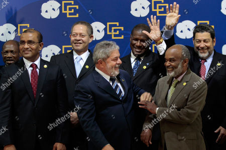 Stock Photo of Bharrat Jagdeo, Luiz Inacio Lula da Silva, Rene Preval, Denzil Douglas, Bruce Golding, Stephenson King, Ralph Gonsalves Leaders, from left to right, first row, Guyana's President Bharrat Jagdeo, Brazil's President Luiz Inacio Lula da Silva and Haiti's President Rene Preval, second row, Saint Kitts and Nevis' Prime Minister Denzil Douglas, Jamaica's Prime Minister Bruce Golding, Saint Lucia's Prime Minister Stephenson King, Saint Vicent and Granadines' Prime Minister Ralph Gonsalves attend the official photo of the Brazil and Caribbean Community Summit at the Itamaraty Palace, Brasilia