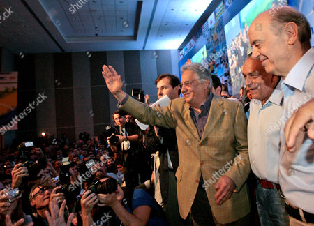 Stock Picture of Jose Serra, Sergio Guerra, Fernando Henrique Cardoso Former Brazil's President Fernando Henrique Cardoso, third from right, Brazil's Senator Sergio Guerra, second from right, and Brazil's former Sao Paulo state Governor and presidential candidate for the Brazilian Social Democracy Party, Jose Serra, right, take part in a campaign rally in Brasilia, . Brazil's general elections are scheduled for Oct. 3