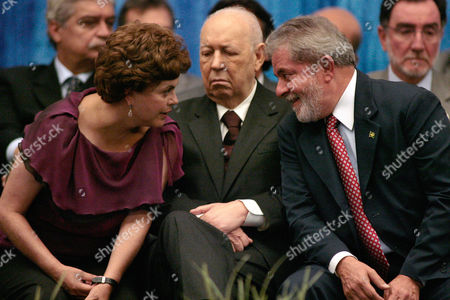 Luiz Inacio Lula da Silva, Dilma Rousseff, Jose Alencar RESENDING TO CHANGE SLUG TO BRAZIL INVESTMENTS ** Brazil's President Luiz Inacio Lula da Silva, right, talks with his chief of staff Dilma Rousseff, left, next to Brazil's Vice President Jose Alencar, during a ceremony to present the second edition of the government's Growth Acceleration Project in Brasilia, . Lula announced investments of $882 billion in infrastructure and social projects from 2011 through 2014