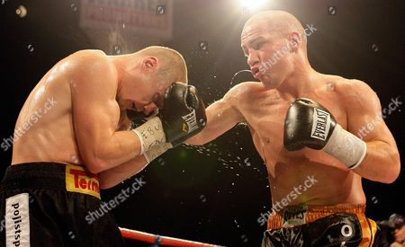 Lukas Konecny of the Czech Republic, right, throws a punch at Britain's Matthew Hall, during their EBU light middleweight title fight boxing match at the LG Arena in Birmingham, England