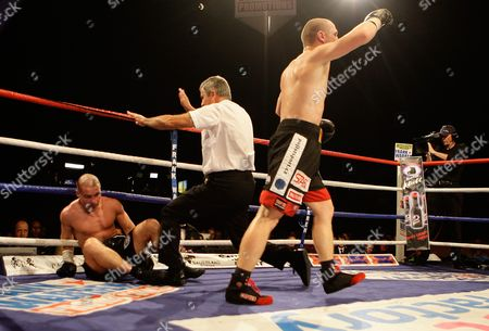 Lukas Konecny of the Czech Republic, right, celebrates after beating Britain's Matthew Hall, during their EBU light middleweight title fight boxing match at the LG Arena in Birmingham, England