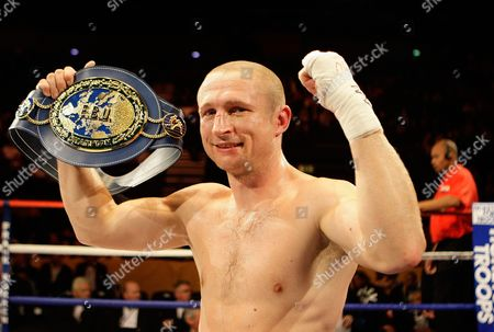 Lukas Konecny of the Czech Republic celebrates with the EBU light middleweight title after beating Britain's Matthew Hall in their boxing match at the LG Arena in Birmingham, England
