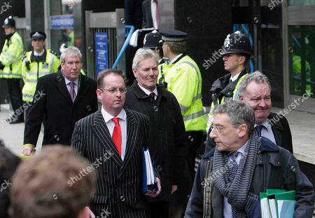 Britain's Labour party's David Chaytor,center with black jacket, Elliot Morley, 3rd left and Jim Devine, partially seen right, leave Westminster Magistrates Court in central London, . The three plus Conservatives party Lord Hanningfield face charges of false accounting last month in relations to their expenses claims.face charges related to their expenses claims. Police began investigating after details of all MPs' expenses claims were leaked to a national newspaper. The three MPs are currently suspended by Labour and Lord Hanningfield suspended by the Conservatives