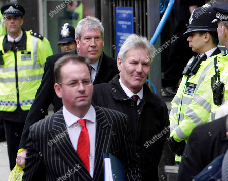 Britain's Labour Party's David Chaytor, center right, and Elliot Morley, behind him left, leave Westminster Magistrates Court in central London, . The two plus Jim Devine, plus Conservatives party Lord Hanningfield face charges of false accounting last month in relations to their expenses claims.face charges related to their expenses claims. Police began investigating after details of all MPs' expenses claims were leaked to a national newspaper. The three MPs are currently suspended by Labour and Lord Hanningfield suspended by the Conservatives