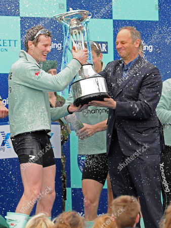 Deaglan McEachern The Cambridge president and former double and quadruple sculls US national champion, Deaglan McEachern, left, takes the Boat Race trophy from Sir Steven Redgrave after winning the 156th running of the Boat Race, London, . On race day up to 250,000 spectators crowd the banks of the Thames from Putney to Mortlake to witness the rowing race between two of England's oldest universities