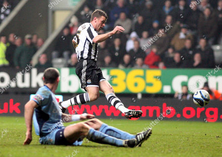 Newcastle United's Ryan Taylor, top, scores his goal past Coventry City's Captain Stephen Wright, bottom, during their English League Championship soccer match at St James' Park, Newcastle, England, . (AP Photo/Scott Heppell) ** NO INTERNET/MOBILE USAGE WITHOUT FOOTBALL ASSOCIATION PREMIER LEAGUE(FAPL)LICENCE. CALL +44