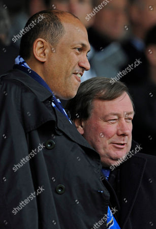 Balram Chainrai, Peter Storrie Portsmouth owner Balram Chainrai, left, stands next to Portsmouth CEO Peter Storrie before their sixth round FA Cup soccer match Birmingham City at the Fratton Park stadium, Portsmouth, England, . (AP Photo/Tom Hevezi) ** NO INTERNET/MOBILE USAGE WITHOUT FOOTBALL ASSOCIATION PREMIER LEAGUE(FAPL)LICENCE. CALL +44