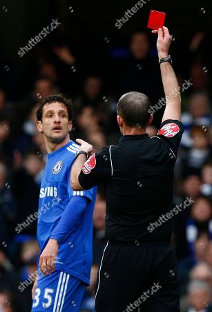 Chelsea's Juliano Belletti, left, is given a red card after a tackle on Manchester City's Gareth Barry during their English Premier League soccer match at Chelsea's Stamford Bridge Stadium in London, . (AP Photo/Kirsty Wigglesworth) ** NO INTERNET/MOBILE USAGE WITHOUT FOOTBALL ASSOCIATION PREMIER LEAGUE(FAPL)LICENCE. CALL +44