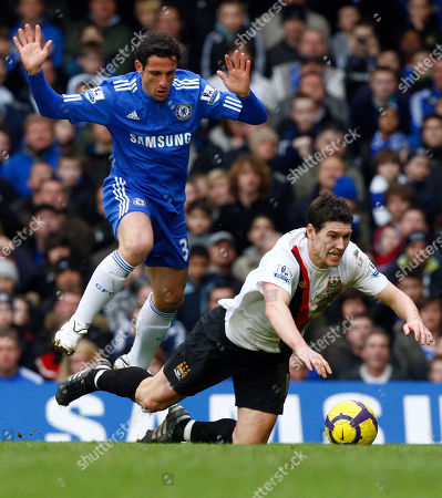 Chelsea's Juliano Belletti, left, tackles Manchester City's Gareth Barry during their English Premier League soccer match at Chelsea's Stamford Bridge Stadium in London, . Juliano Belletti was given a red card for the tackle. (AP Photo/Kirsty Wigglesworth) ** NO INTERNET/MOBILE USAGE WITHOUT FOOTBALL ASSOCIATION PREMIER LEAGUE(FAPL)LICENCE. CALL +44