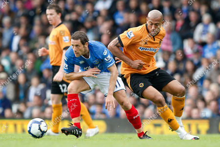 Michael Brown, Chris Iwelumo Portsmouth's Michael Brown, left, competes with Wolverhampton Wanderers' Chris Iwelumo during their English Premier League soccer match at Fratton Park, Portsmouth, England, . (AP Photo/Sang Tan) ** NO INTERNET/MOBILE USAGE WITHOUT FOOTBALL ASSOCIATION PREMIER LEAGUE (FAPL) LICENCE - CALL +44