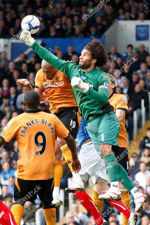 David James, Chris Iwelumo Portsmouth's goalkeeper David James, right, punches the ball away from Wolverhampton Wanderers' Chris Iwelumo during their English Premier League soccer match at Fratton Park, Portsmouth, England, . (AP Photo/Sang Tan) ** NO INTERNET/MOBILE USAGE WITHOUT FOOTBALL ASSOCIATION PREMIER LEAGUE (FAPL) LICENCE - CALL +44