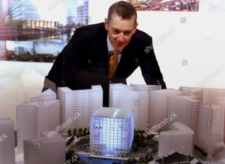 Stock Photo of James Timberlake Architect James Timberlake looks at a model of his winning design for the new US Embassy for London, during the announcement of the winners, in London, . The new embassy design by architect firm Kieran Timberlake of Philadelphia, Pennsylvania will be built in Battersea, south London