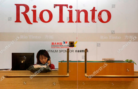 A receptionist answers the phone at the Riot Tinto office in Shanghai. Global miner Rio Tinto's CEO Tom Albanese shrugs off doubts over the prospects for the company's proposed iron ore joint venture in Australia with BHP Billiton, saying he will do everything he can to win regulatory approval for a deal that is meeting opposition from big ore buyers like China