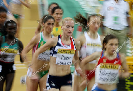 Britain's Barbara Parker, center, competes in a Women's 3000m heat at the 13th IAAF World Indoor Championships in in Doha, Qatar