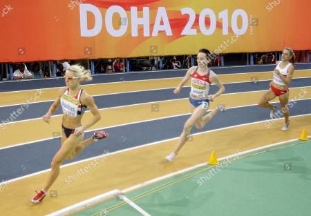 Britain's Jenny Meadows, left, leads Russia's Mariya Savinova and Angelika Cichocka of Poland during a Women's 800m heat at the 13th IAAF World Indoor Championships in in Doha, Qatar