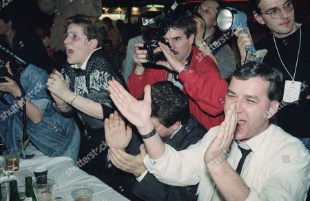 Christian Democrats celebrate victory in the East German election at party headquarter in East Berlin on Sunday in March 1990. They are applauding party chairman Lothar de Maiziere (not shown