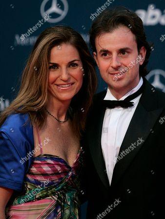 Spanish former professional tennis player Arantxa Sanchez-Vicario, left, and her husband Jose Santacana, as they arrive for the Laureus Awards in Abu Dhabi, United Arab Emirates