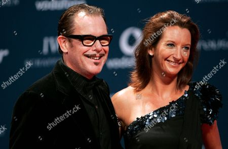 Former professional surfer from Australia, Layne Beachley, right, arrives with her husband for the Laureus Awards in Abu Dhabi, United Arab Emirates