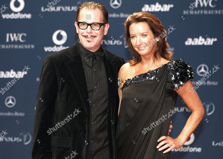 Layne Beachley Former professional surfer from Australia, Layne Beachley, right, arrives with her husband for the Laureus Awards in Abu Dhabi, United Arab Emirates