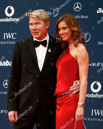 Mika Hakkinen, Marketa Kromatova Laureus Sport Academy member Mika Hakkinen and his girl friend Marketa Kromatova arrive at the Laureus World Sports Awards, United Arab Emirates