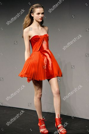 Stock Photo of FILE- This photo shows a model wearing a creation from Versace's Versus women's fall-winter 2010/2011 collection during Milan Fashion Week in Milan, Italy. For a red, strapless short cocktail dress, like this one from Versace's Versus collection, actress Kate Bosworth says she'd choose something with a tough edge to contrast the flirtiness of the frock. Bosworth and celebrity stylist Cher Coulter have created a line of contemporary jewelry called Jewelmint that aims to suit all sorts of looks