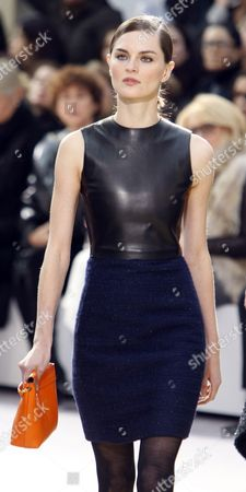 A model wearing a creation by French fashion house Celine from the fall-winter 2010-2011 ready-to-wear collection presented in Paris. Celebrity stylist Cher Coulter would pair a statement necklace or a low-hanging chain necklace with this dress by Celine, while actress Kate Bosworth would choose Jewelmint's Sword Stone ring, which has an abstract gold base and a black stone. Bosworth and Coulter have created a line of contemporary jewelry called Jewelmint that aims to suit all sorts of looks