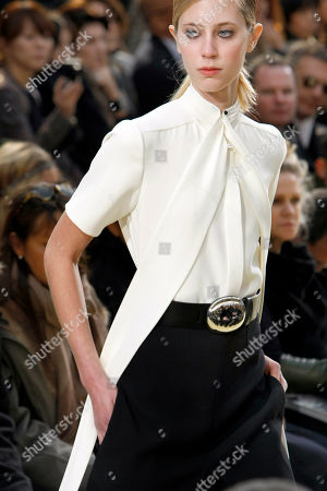 Stock Image of FILE- A model wears a creation by French fashion house Celine during their fall-winter 2010-2011 ready-to-wear presentation in Paris. Celebrity stylist Cher Coulter likes the chunky belt buckle worn with this design on the runway, but if there's already one big piece like that, the rest of the jewelry has to work around it, she says. With the high neck typical of a scarf-style blouse, actress Kate Bosworth likes the idea of earrings. Bosworth and Coulter have created a line of contemporary jewelry called Jewelmint that aims to suit all sorts of looks