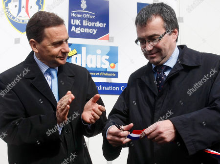 Eric Besson, Phil Woolas French Immigration Minister Eric Besson, left, and British Minister for Borders and immigration Phil Woolas inaugurate the Joint Operational Coordination Center which aims at fighting illegal immigration between the two countries, in the harbor of Calais, northern France
