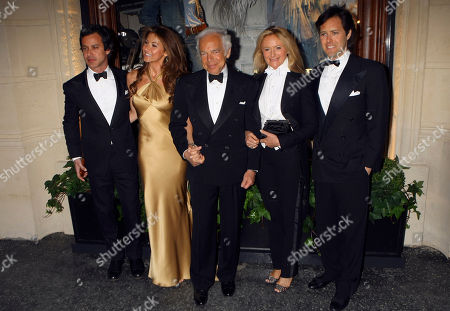 US fashion designer Ralph Lauren, center, with his wife Ricky, second right, and son David, left, daughter Dylan Lauren, second left, and a son Andrew Lauren as they arrive at the inauguration of Lauren's new shop in Paris
