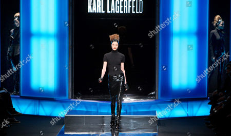 A model wears a creation by German designer Karl Lagerfeld for Largerfeld as part of his Fall-Winter ready-to-wear fashion collection 2010, presented in Paris