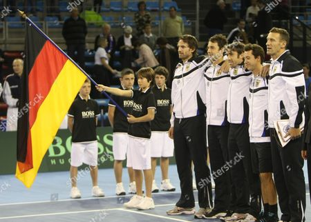 Benjamin Becker, Christofer Kas, Simon Greul, Philipp Kohlschreiber, Patrick Kuehnen Germany' national team Benjamin Becker, third left, Christofer Kas, left, Simon Greul, second left, Philipp Kohlschreiber, second right, and captain Patrick Kuehnen, listen to the national anthem during the opening of the Davis Cup tennis first round, in Toulon, southern France