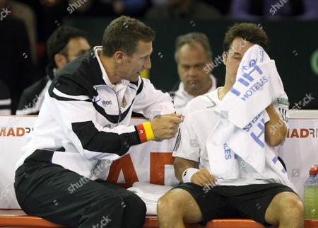 Philipp Kohlschreiber, Patrick Kuehnen Germany' captain Patrick Kuehnen, left, talks with Philipp Kohlschreiber, during their Davis Cup first round tennis match against France's Gael Monfils, in Toulon, southern France