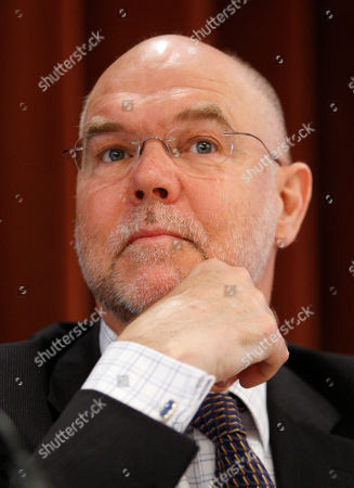 Stock Photo of Malcolm Brinded Britain's Malcolm Brinded, Executive Director Exploration & Production, Royal Dutch Shell plc., pauses as he speaks to the assembly during the 11th International Oil Summit in Paris