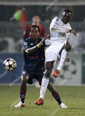 Jean II Makoun, Mahamadou Diarra Lyon's Jean II Makoun of Cameroon, left, challenges Real Madrid's Mahamadou Diarra of Mali for the ball during their Champions League round of 16 soccer match in group E, Tuesday, Feb. 16, 2010, in Lyon stadium, central France